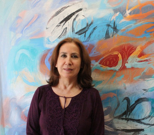 Jacqueline Unanue artist and one of her paintings in Ancient Land