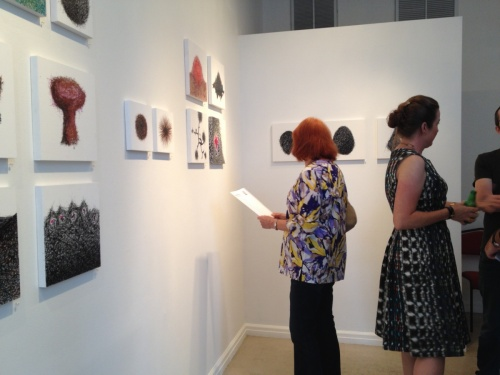 Artist Reception, checking out the small works.