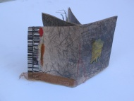 Cover, One sheet book from drawing collage with found words and object, stitching